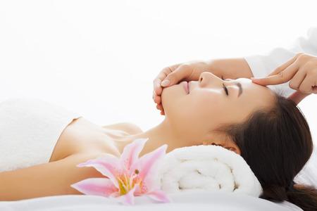 asian massage: young beautiful woman in spa salon Stock Photo