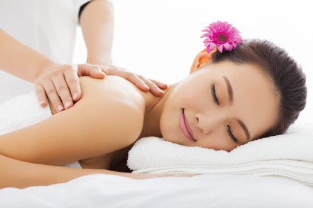 spas: young woman in spa salon getting massage Stock Photo