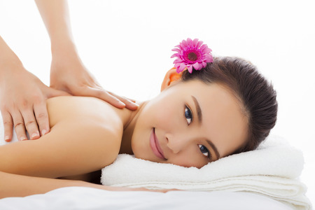 natural face: young woman in spa salon getting massage Stock Photo