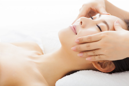 woman in spa: massage of face for woman in spa salon