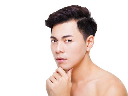 asian style: closeup charming young man face Stock Photo