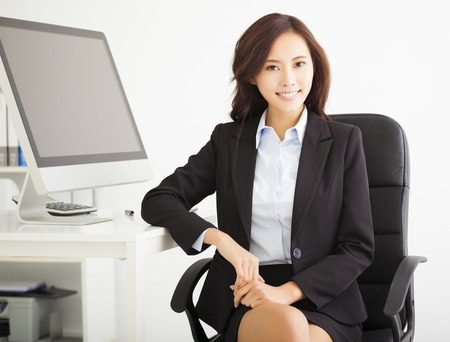 asian office lady: happy young businesswoman working in the office Stock Photo