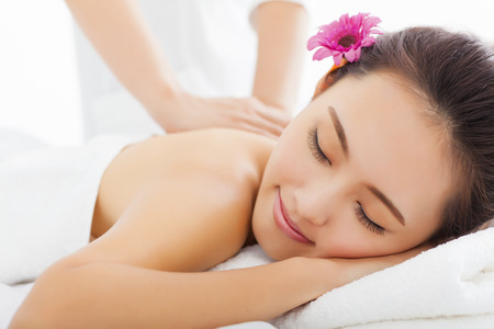 salon and spa: young woman in spa salon getting massage Stock Photo