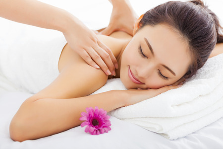 pamper: young woman in spa salon getting massage Stock Photo