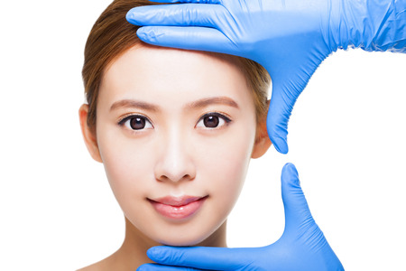young attractive  woman face and medical beauty concept
