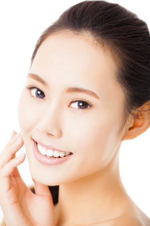 face and shoulders: closeup smiling young  woman face isolated on white Stock Photo