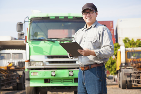 happy truck driver writing on a document Stock Photo