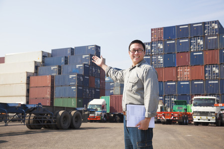 shipping order: happy man in front of container truck