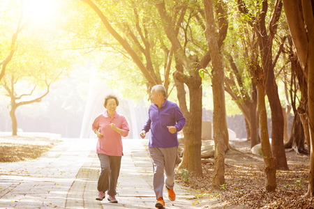 family exercise: happy asian Senior Couple Exercising In the Park