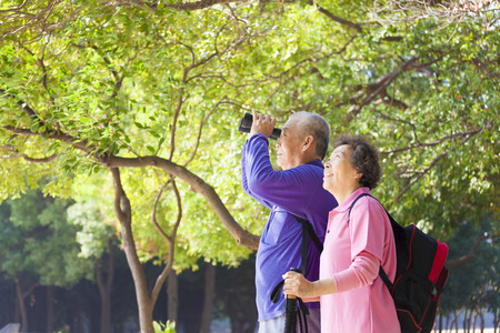 old: Happy asian senior Couple On Vacation Stock Photo