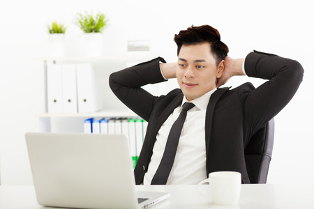 men in suits: Young business man working in the  office