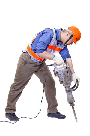 construction safety: worker with pneumatic hammer drill equipment isolated on white