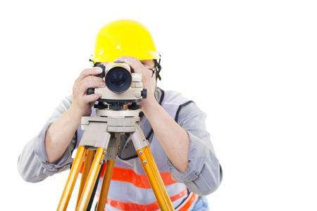 Surveyor worker making measurement  and isolated on white photo