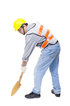 safety gear: Worker digging with  shovel isolated on white Stock Photo