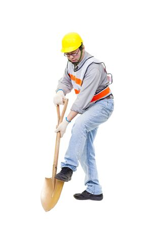 Worker digging with  shovel isolated on white Stock Photo