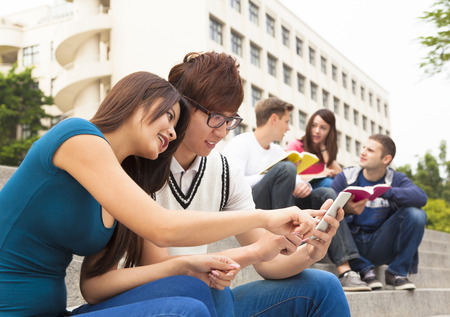young couple student touching the smartphone Stock fotó