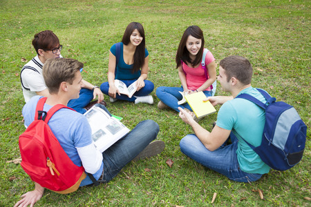 grounds: College students studying and discuss together in campus Stock Photo