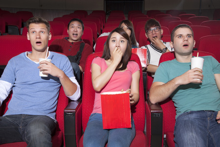 watch groups: Young people  watching a movie at the cinema