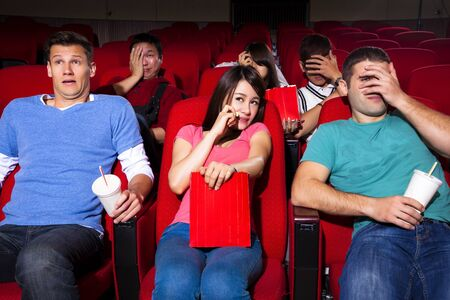 Young people  watching a movie at the cinema photo