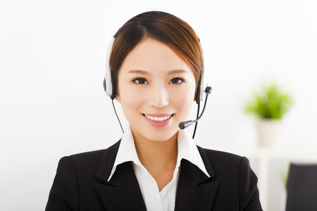 computer operator: young beautiful businesswoman with headset in office Stock Photo