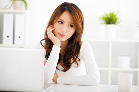 pretty woman face: Stressed young woman with laptop