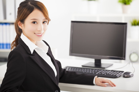 happy asian people: young asian business woman working in the office
