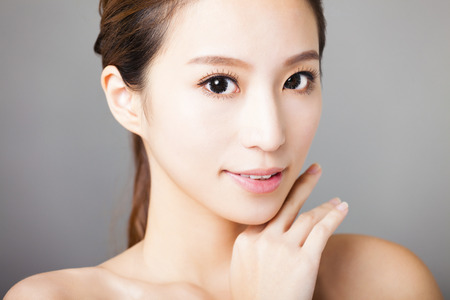 closeup smiling young  beautiful  woman face Stock Photo