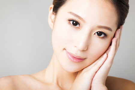 face: closeup smiling young  beautiful  woman face Stock Photo
