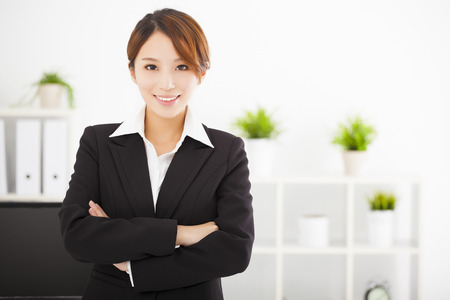 copyspace corporate: young business woman working in the office