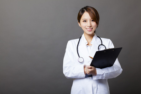 smiling female doctor with clipboard photo