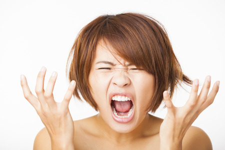 face: Closeup stressed young woman and yelling screaming