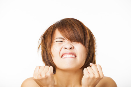 annoyed: Closeup angry young woman face Stock Photo
