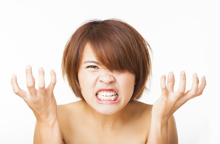Closeup angry young woman and yelling screaming Archivio Fotografico