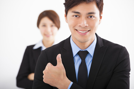 Handsome happy business man with thumbs up Stock Photo