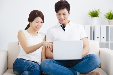 asian wife: asian Couple on sofa with laptop computer Stock Photo