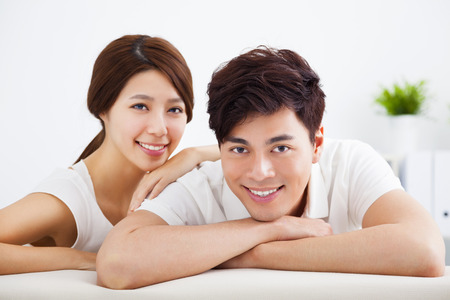 couple on couch: Portrait of sweet couple sitting in sofa