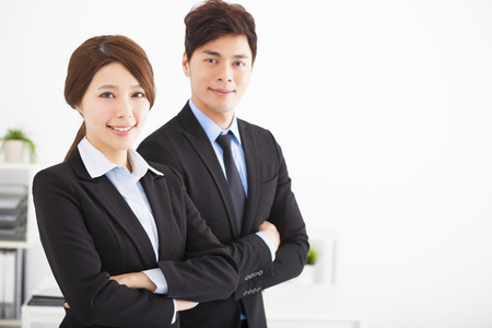 happy businessman: young business man and woman in the office