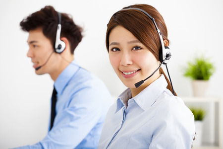 headphones: businesswoman and businessman with headset working in office