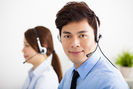 headset business: businessman and businesswoman with headset working in office
