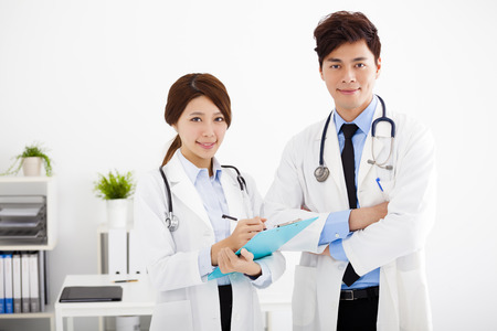 Male and female medical doctors working in a hospital office