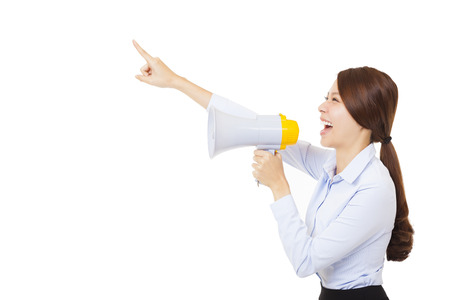 young businesswoman using megaphone isolated on white
