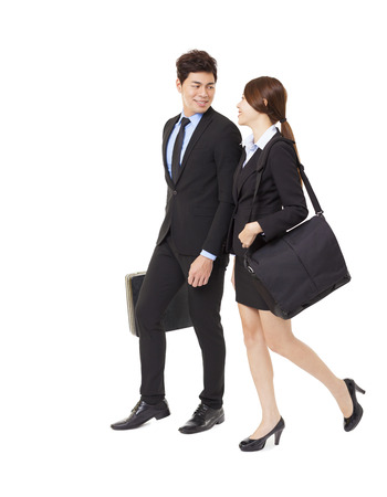 moving office: happy businessman and businesswoman walking together isolated on white