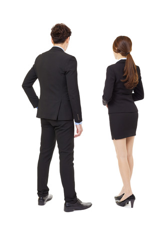 BUSINESSMEN: rear view businessman and businesswoman  standing Stock Photo