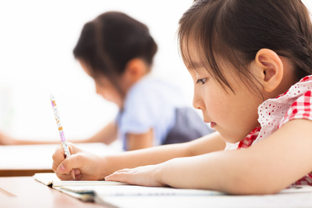 kid drawing: happy children study in the classroom