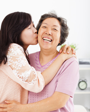 happy daughter kissing her mother photo