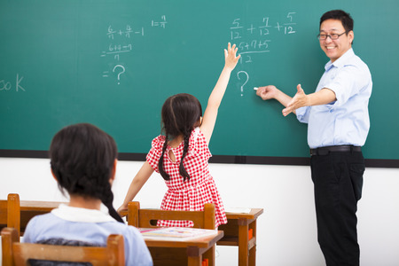 questions answers: teacher asking question with children  in classroom