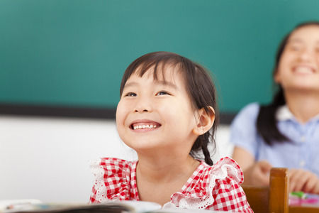 happy little girls in the classroom photo