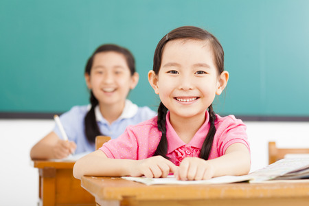 elementary education: happy little girls in the classroom