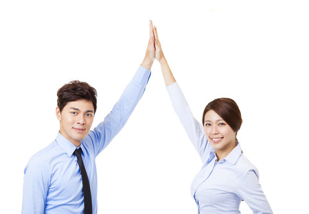business man and woman joining hands and cooperation concept Stock Photo