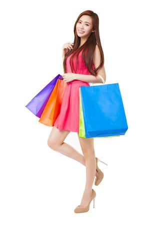 chicas compras: mujer joven con bolsas de compra  Foto de archivo